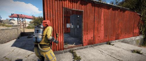 Пройдите в красный контейнер справа снаружи